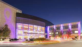 Moores Cancer Center lit in purple
