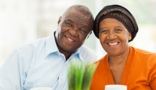 older african american couple smiling