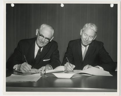 Frank Gibson and John Galbraith signing agreement to creat UC San Diego Hospital