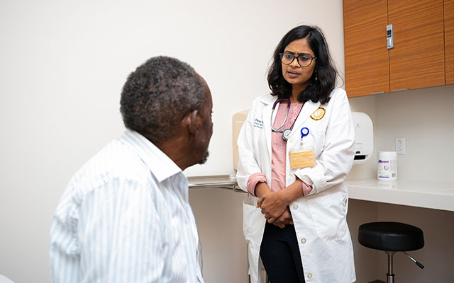 Dr. Gopal with patient