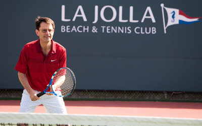 Scott Lippman, MD playing tennis