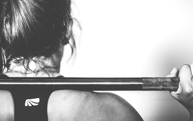 woman with weighted bar