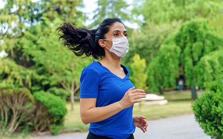 woman running while masked