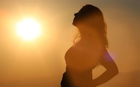woman standing in sunshine