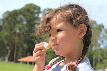 girl eating marshmallow