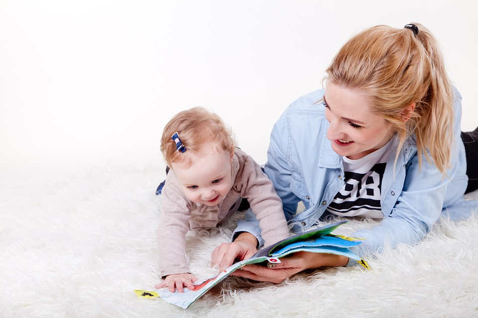 image of mom and child eading
