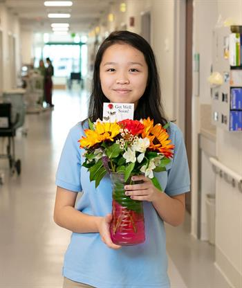 girl with flower arrangement