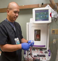 A technician prepares to administer photopheresis