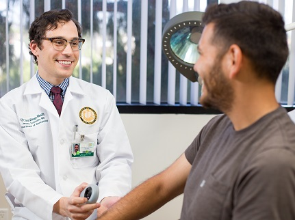 Dr. David Schneider and patient
